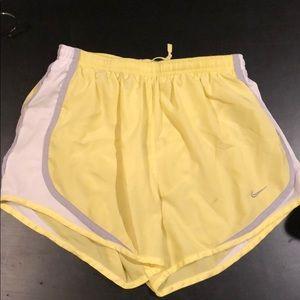 Yellow Nike DriFit shorts